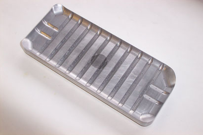 Bacon pack, with ferrous insert for lifting by magnet